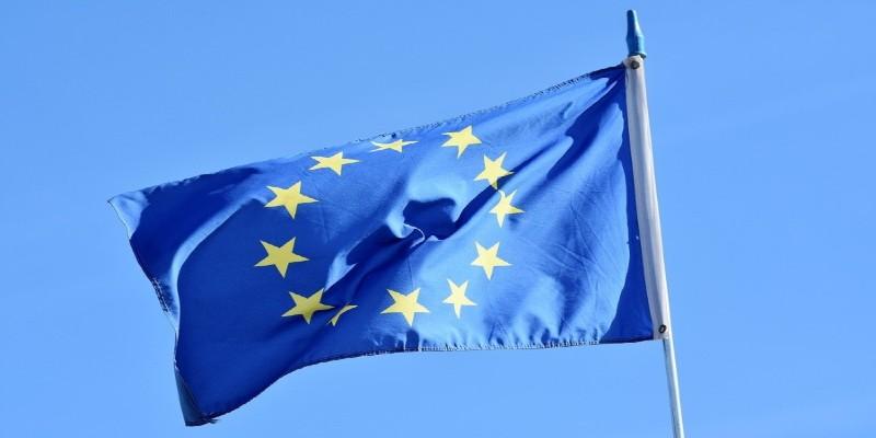 The European flag flying against a clear blue sky.