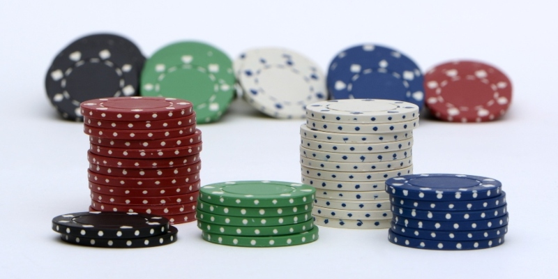 Stacks of casino chips against a white background; JackpotCity Casino Blog