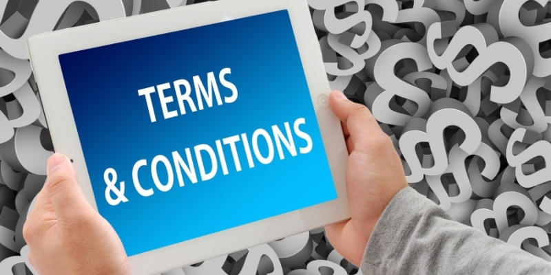 """Hands holding a tablet showing """"Terms and Conditions""""; JackpotCity Casino Blog"""