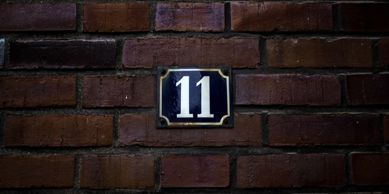 Brick wall with number 11 sign