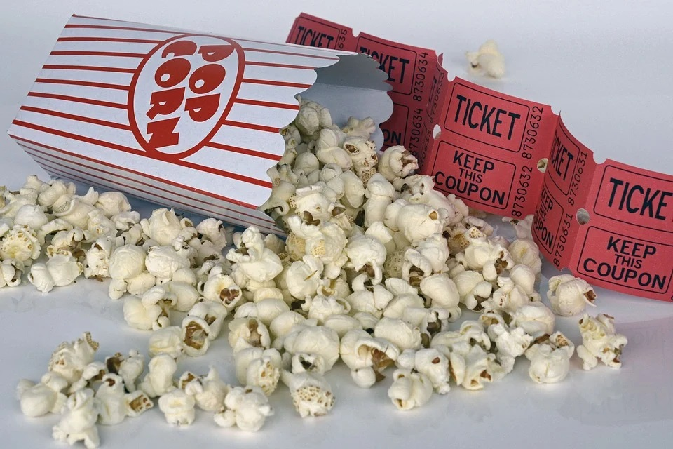 Movie tickets and popcorn.