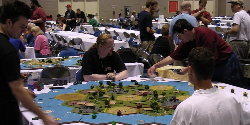 People playing board games; Spin Palace Blog