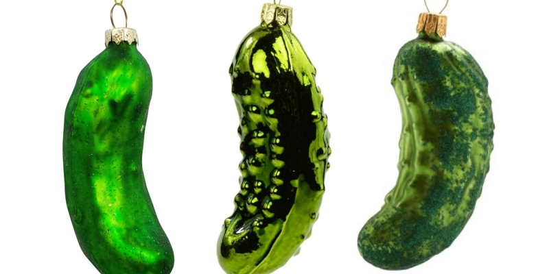 three Christmas pickle ornaments, used for the tradition of Weihnachtsgurke
