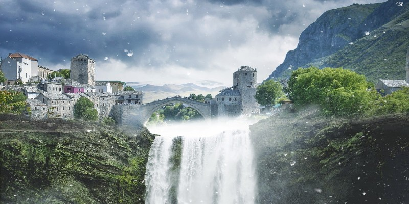 City with a waterfall in the front - Spin Casino Blog
