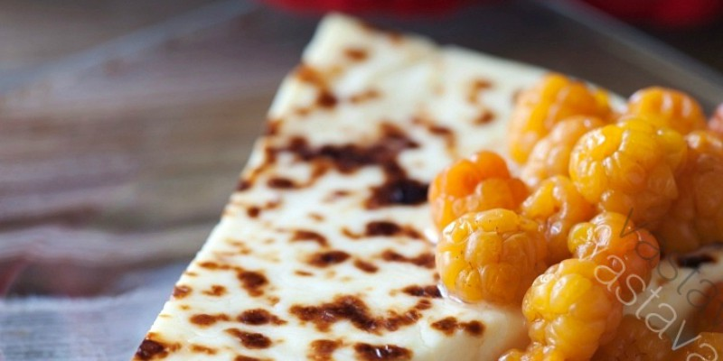 slice of Finnish squeaky cheese and dollop of cloudberry jam