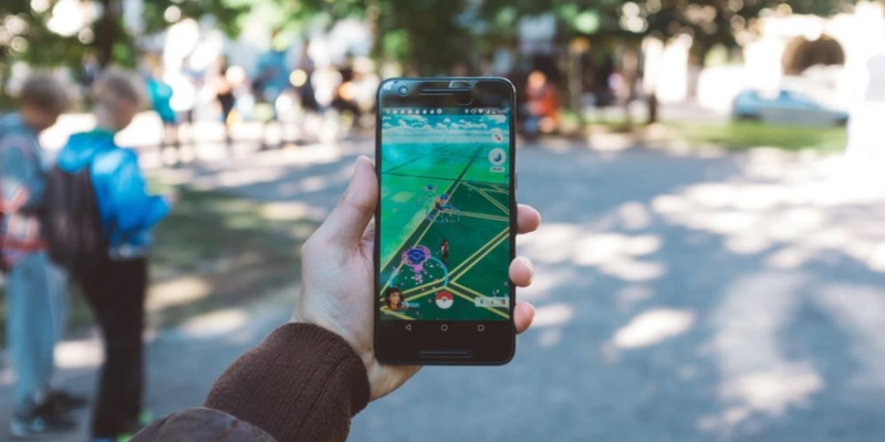 Person playing Pokemon Go in a park; Spin Casino blog