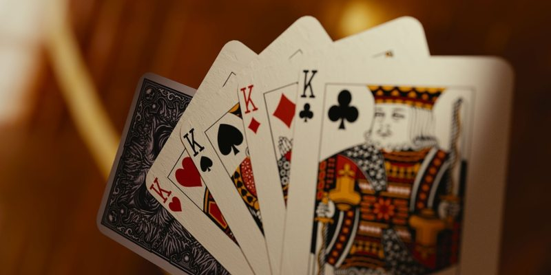 Four fanned-out cards all showing Kings; Spin Casino Blog