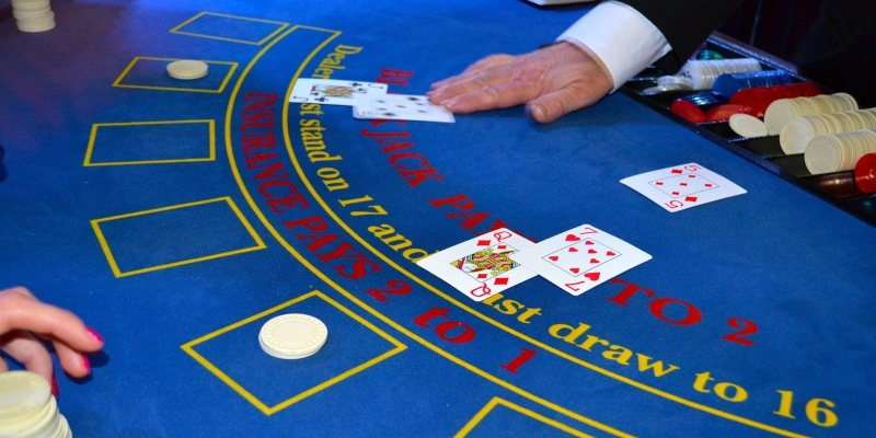 Blackjack table with dealer's hands visible