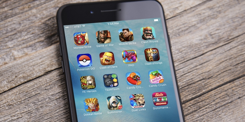 iPhone with game icons; Spin Casino Blog