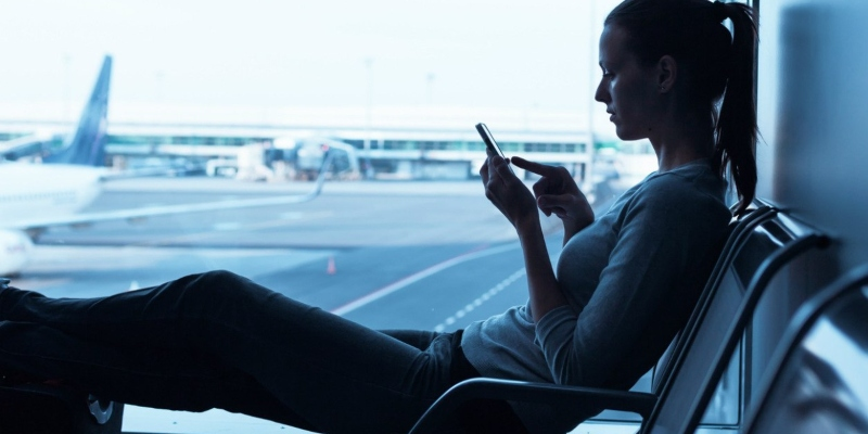 girl using smartphone at an airport