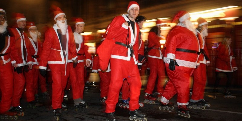 Several men roll by in Santa suits while on roller skates as they skate to mass in Caracas; Spin Palace Blog