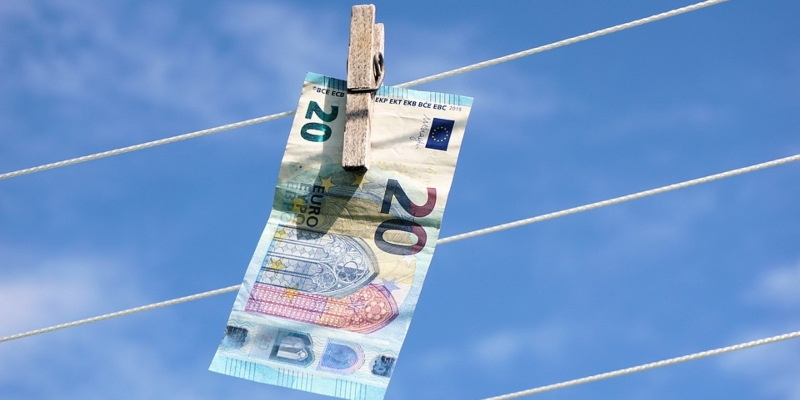 A Euro note hanging on a clothesline - Spin Palace Blog