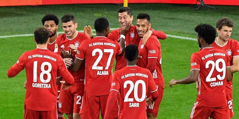 Bayern Munich players celebrate beating Borussia Dortmund last time out