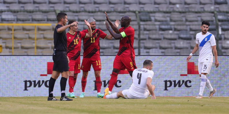 Belgium celebrate a goal in their friendly draw with Greece