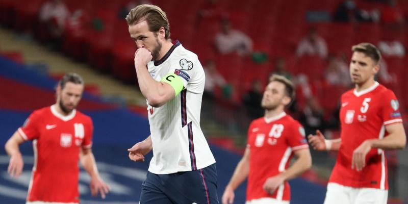 England captain Harry Kane celebrates scoring against Poland