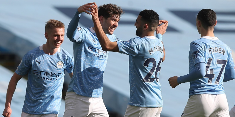 John Stones celebrates with his teammates in Manchester City's win over West Ham