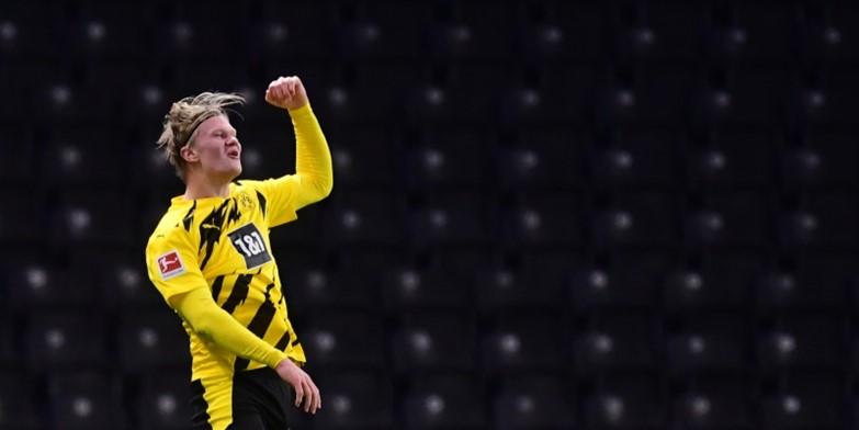 Erling Braut Haaland celebrates scoring four against Hertha Berlin