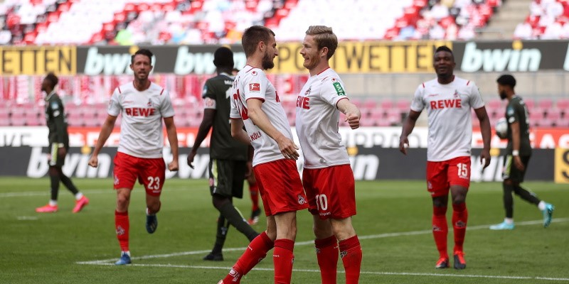 Koln's Florian Kainz celebrates with teammate Dominick Drexler