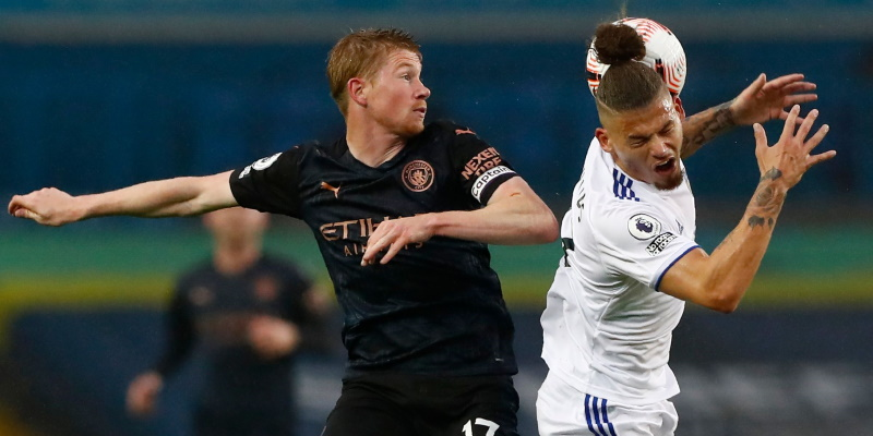 Kevin De Bruyne fights for the ball with Leeds United's Kalvin Phillips in October; Spin Sports Blog