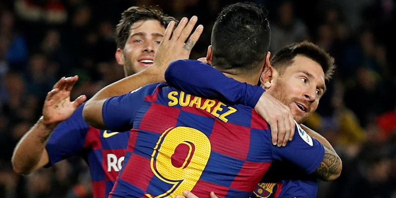 Lionel Messi and Luis Suarez celebrate; Spin Sports Blog