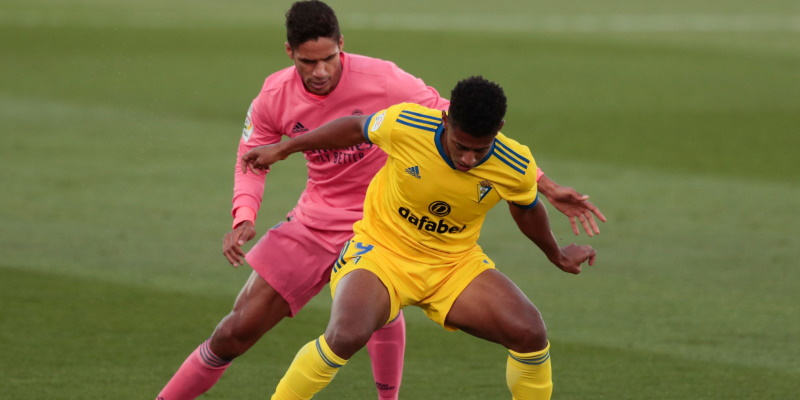 Anthony Lozano shields the ball from Raphael Varane in Cadiz's win over Real Madrid in October