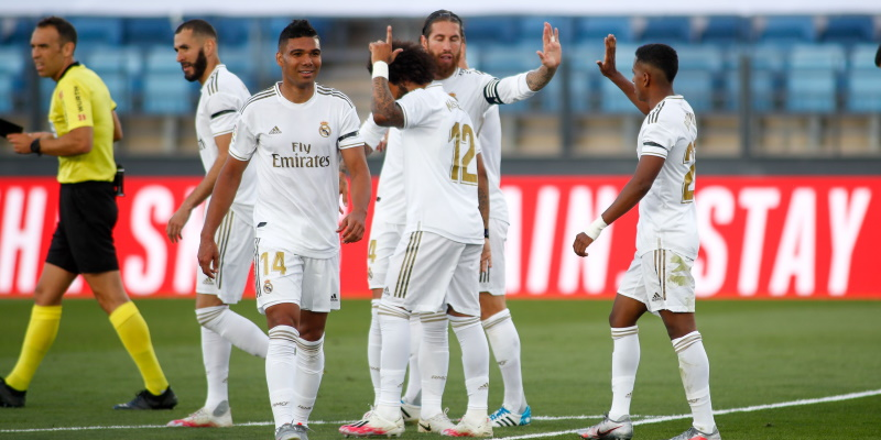 Real Madrid players celebrate a Marcelo goal against Eibar