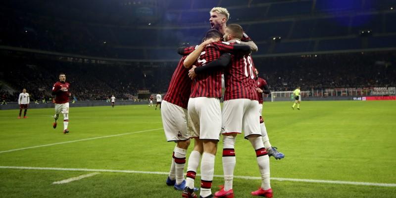 Milan players celebrate earlier in the season