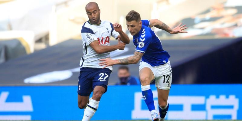 Tottenham's Lucas Moura jostles with Everton's Luca Digne