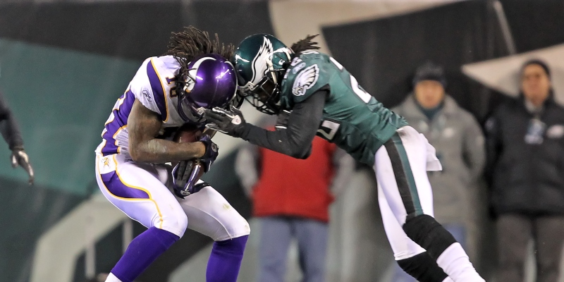 Two American football players colliding