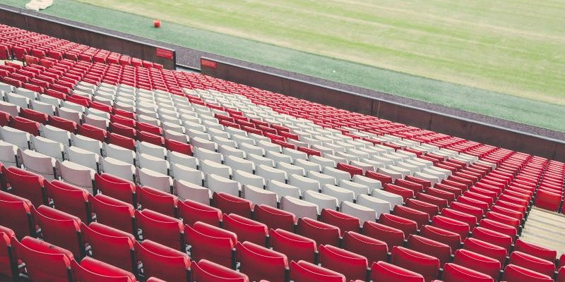 A photograph of empty seats at Liverpool's Anfield stadium.