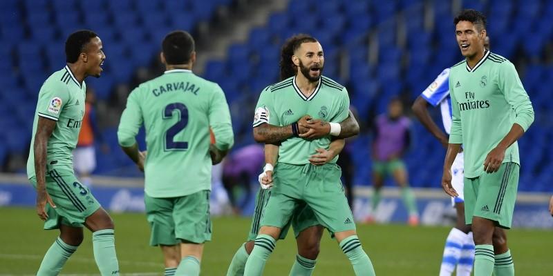 Karim Benzema celebrates with his Real Madrid teammates