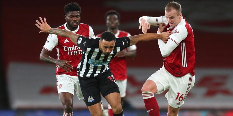 Rob Holding and Thomas Partey challenge Newcastle's Callum Wilson