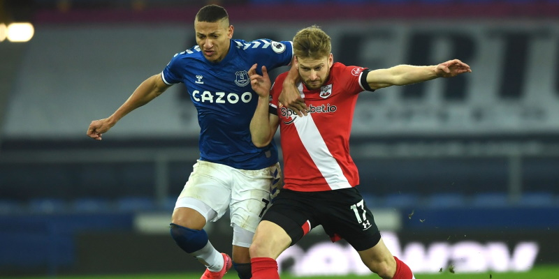 Southampton's Stuart Armstrong challenges Everton forward Richarlison