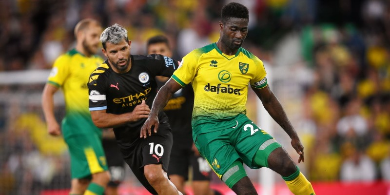 Sergio Aguero chases Alex Tettey in the September meeting between the teams