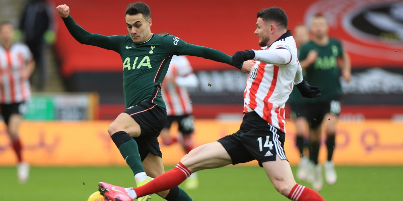 Sergio Reguilon and Oliver Burke challenge for the ball earlier in the season