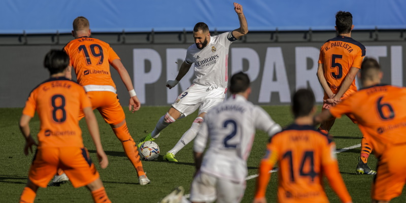Five Valencia players confront Real Madrid's Karim Benzema