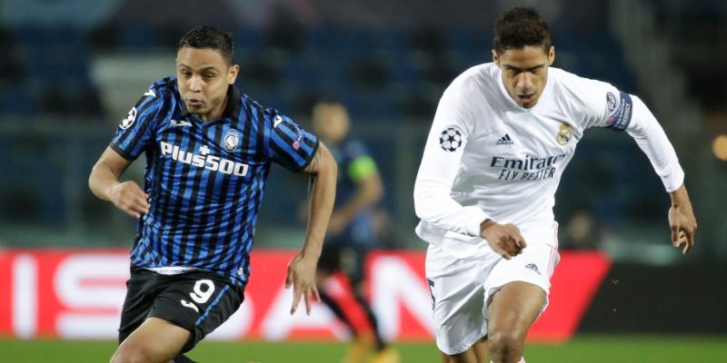 Atalanta striker Luis Muriel takes on Real Madrid's Raphael Varane