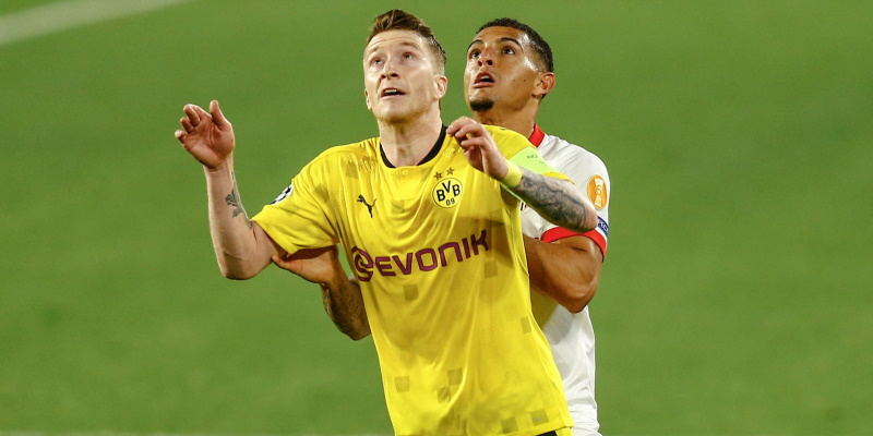 Marco Reus of Borussia Dortmund and Diego Carlos of Sevilla compete in the first leg