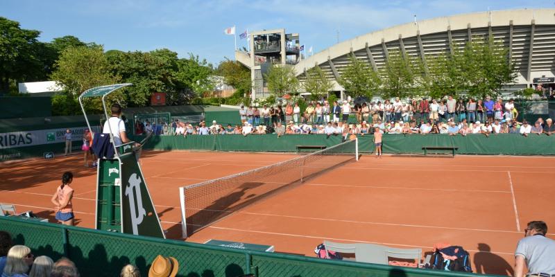 The distinctive red courts at Roland Garros Stadium