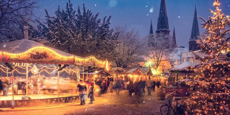 Christmas market with lights and snow