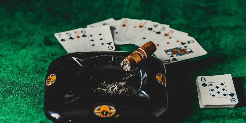 casino cards and a cigar