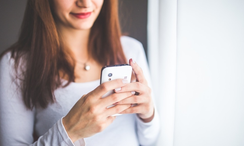 A woman playing on her phone
