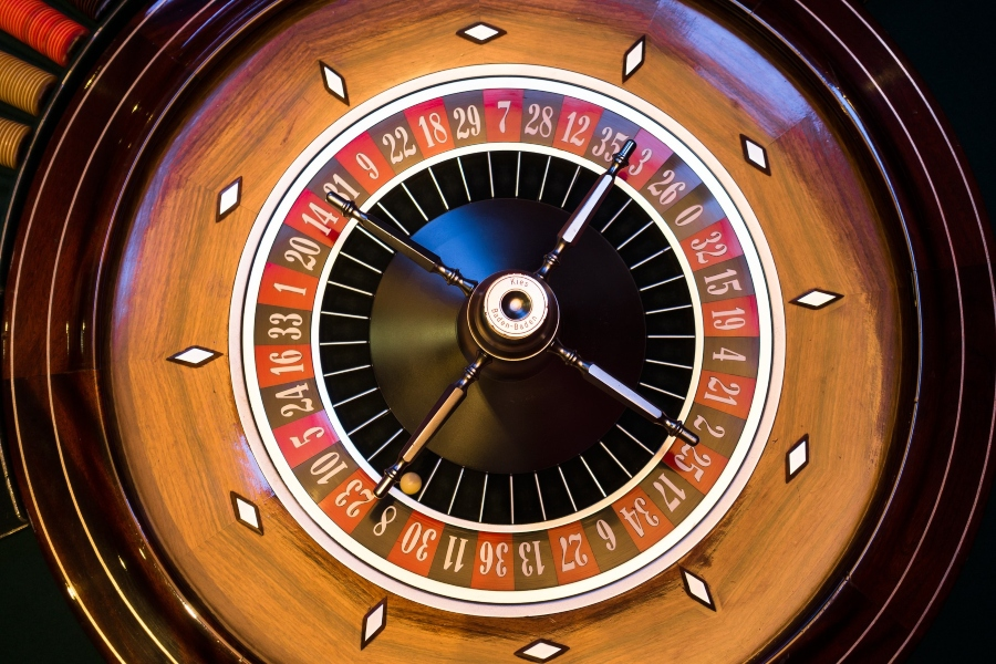 A top-down shot of a French Roulette wheel.