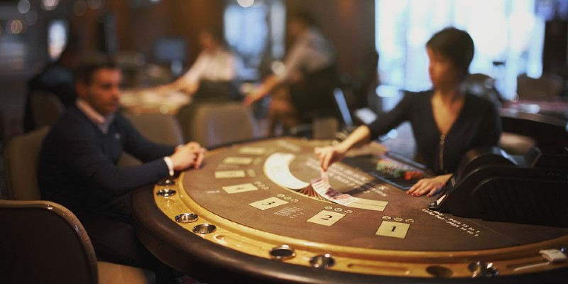 Croupier and player at table