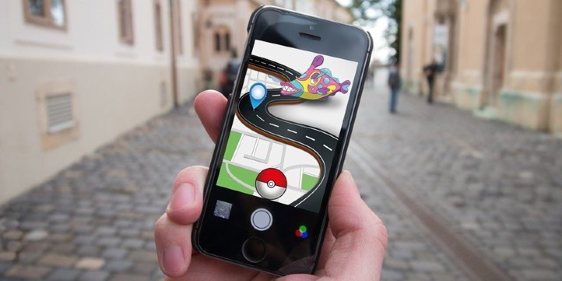 Pokemon Go on a smartphone screen in the street