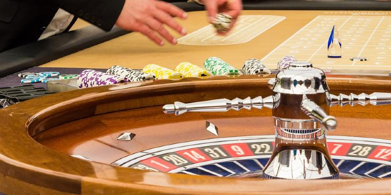 Roulette croupier at table