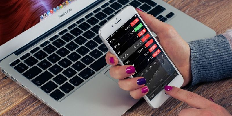 Woman trading stocks on a smartphone app